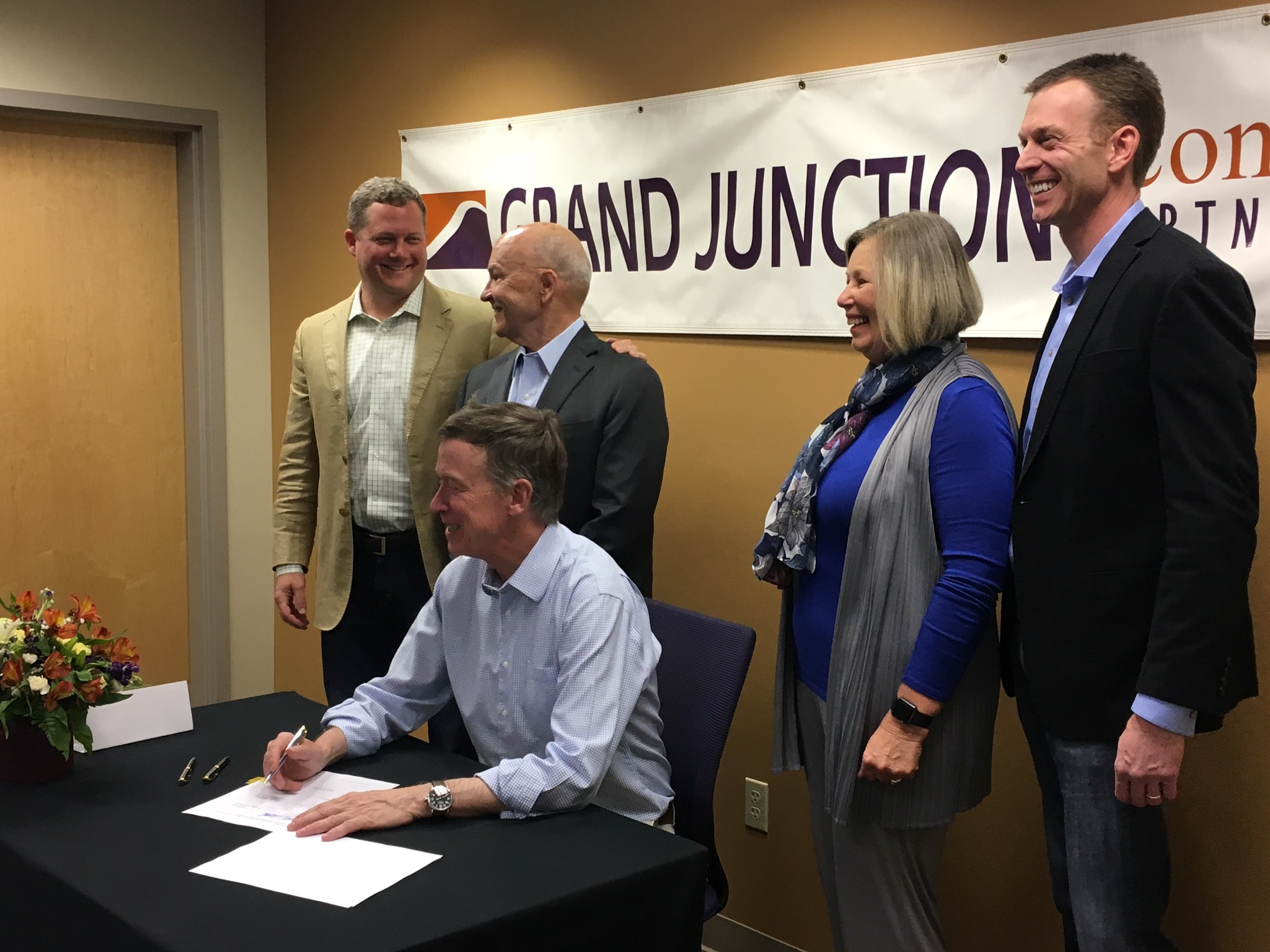 Gov. Hickenlooper signs a bill at GJEP, Grand Junction, CO